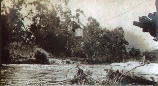flying-fox-over-kiewa-river-near-damaged-bridge-timbers